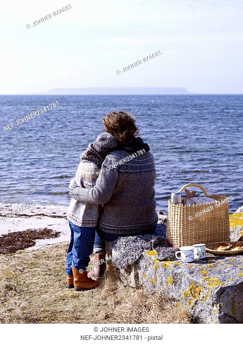 Woman with boy on beach