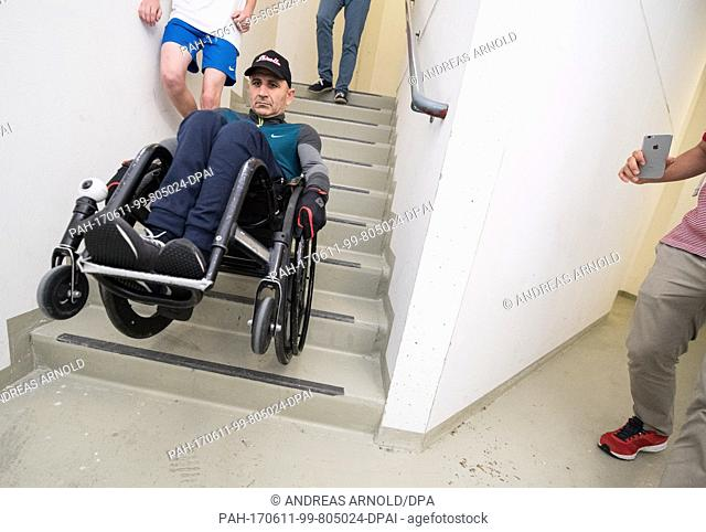 Haki Doku and his wheelchair from Italy takes on the race from top down in Frankfurt am Main, Germany, 11 June 2017. Over 1000 runners took on 1202 stairs