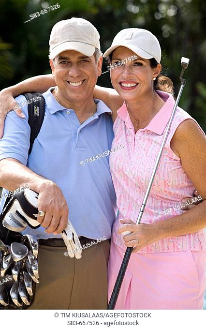 Couple playing golf