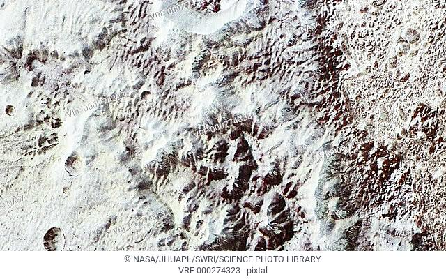 Mountains and ice on Pluto. New Horizons view of landscapes of mountains and ice on the dwarf planet Pluto. Great blocks of Pluto's water-ice crust rise up to...
