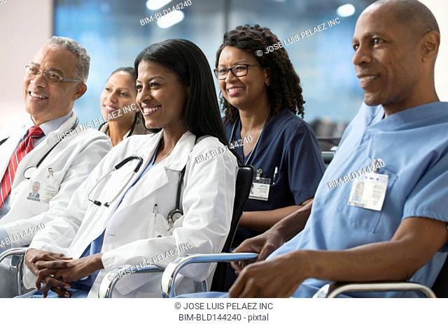 Doctors listening to presentation at conference