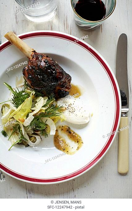 Slow roasted lambs leg with cabbage fennel salad