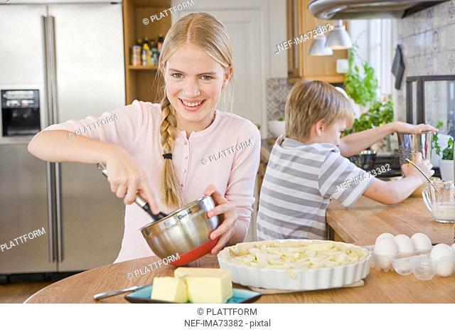 Sister and brother making a cake, Sweden