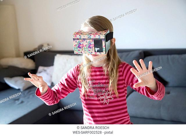 Fumbling girl with Virtual Reality Glasses