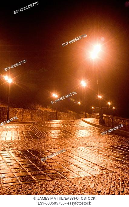 Rainy night streets refect the gold and silver mining traditions of romantic Guanajuato, Mexico