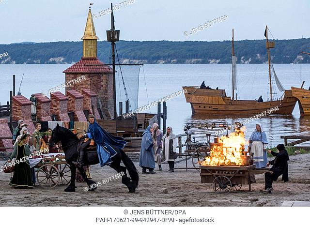 Bastian Semm as pirate Klaus Stoertebeker rides past a burning market stand at the nature stage in Ralswiek on Ruegen island, Germany, 21 June 2017
