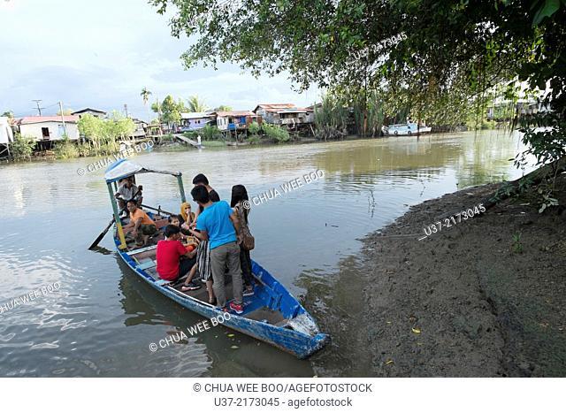 Crossing Apong river, Kuching, Sarawak, Malaysia