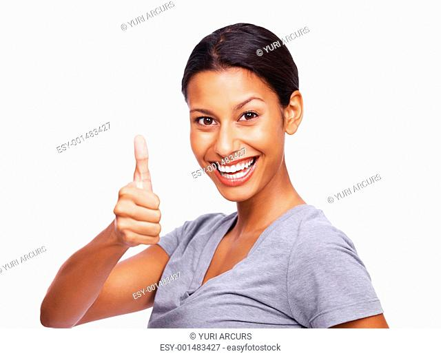 Portrait of a happy young woman gesturing thumbs up sign isolated over white background
