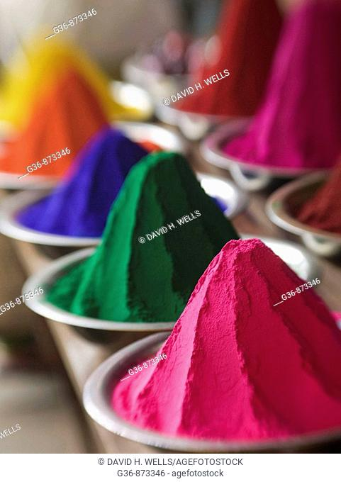 Colored powder used in rituals for sale in the main market in Mysore, Karnataka, India (intentional selective focus)