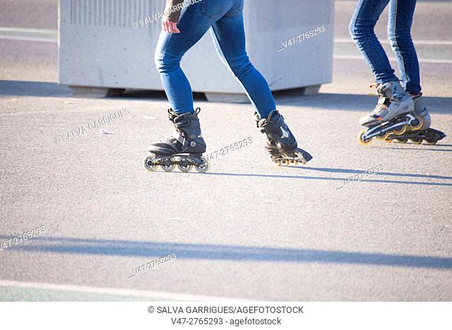 Young people skating through the streets of Valencia, Spain, Europe