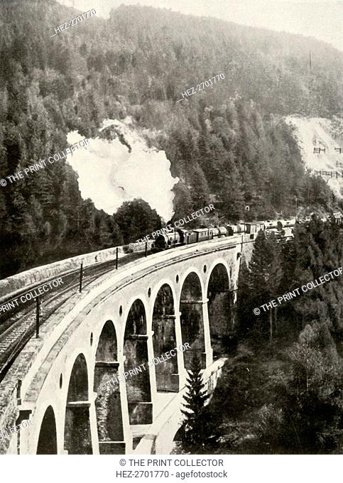 'In the Semmering Valley, Austria. A good train crossing the curved Gamperl Viaduct', 1935-36. Creator: Unknown