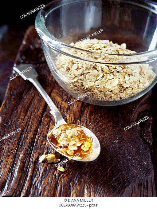 Honey and porridge oats on spoon