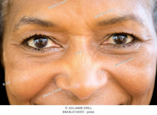Close up of mixed race woman smiling
