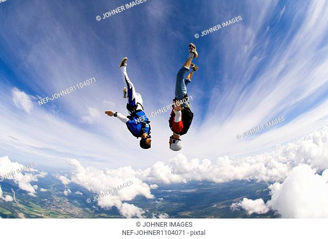 Young couple upside-down in air