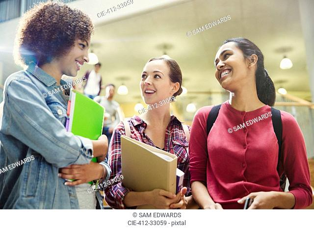 College students smiling and talking