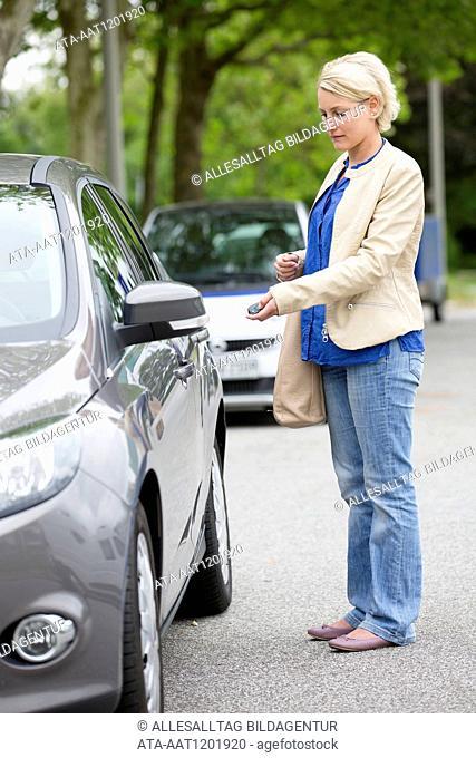 Female car driver opens her car