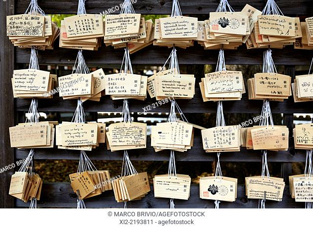 Ema are small wooden plaques on which Shinto worshippers write their prayers or wishes. Senso-ji temple, Tokyo, Japan