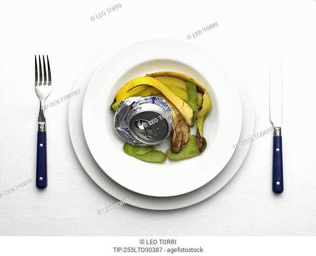 Dish of compacted aluminum can and banana peel