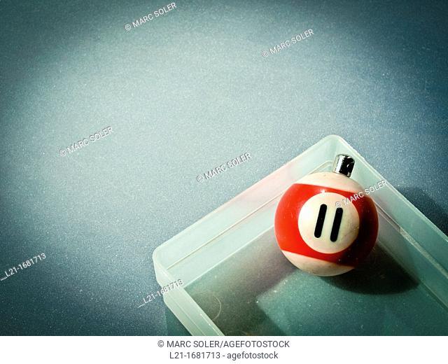 Number 11, billiard ball in a little plastic box