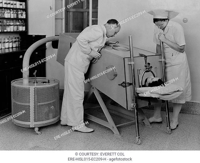 Polio patient in an iron lung at the Scots Mission Hospital in Tiberias, Palestine in March 1940. When polio weakened muscles used in breathing, an iron lung