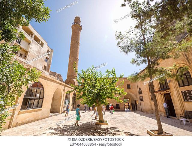 Unidentified children play at courtyard of Abdullatif Mosque which was built during Artuklu period in Mardin,Turkey. 17 June 2018