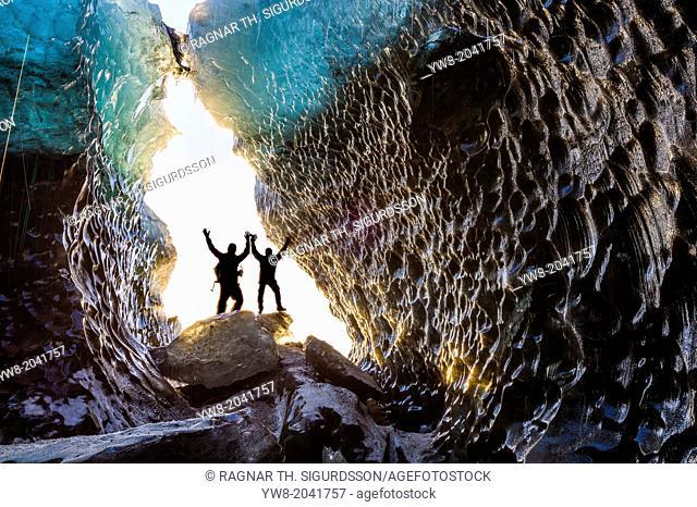 Exploring a glacial ice cave, Svinafellsjokull, Iceland