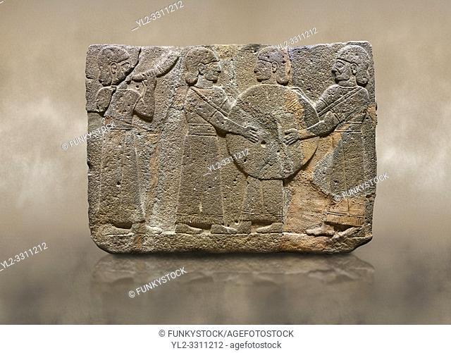 Photo of Hittite monumental relief sculpted orthostat stone panel of Procession. Basalt, Karkamıs, (Kargamıs), Carchemish (Karkemish), 900 - 700 B