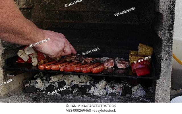 Barbecue grill with meat, sausages, vegetable and cheese