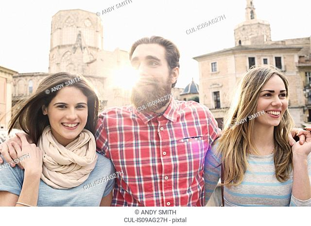 Three young tourists, Plaza de la Virgen, Valencia, Spain