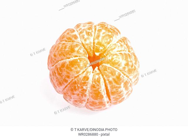 Fruits , peeled off juicy orange on white background