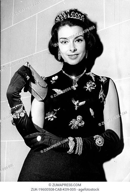 Dec. 21, 1959 - Paris, France - Model FABIENNE SHINE wearing some of the jewels that value 200 million francs at a fashion show