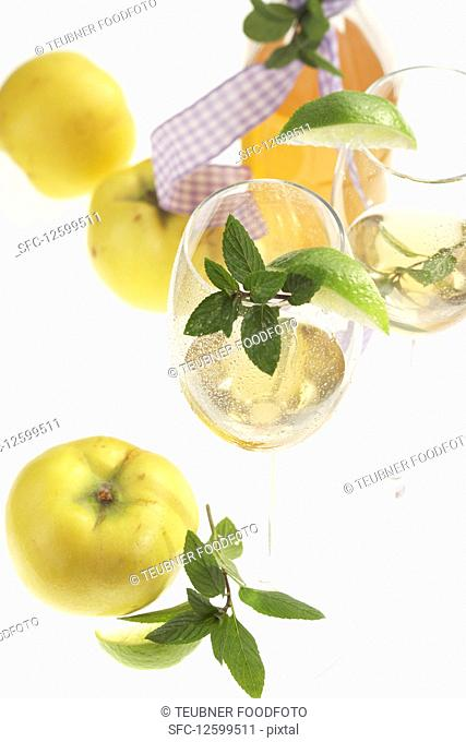 Homemade quince liqueur with fresh fruit