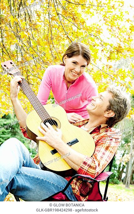 Couple with a guitar in a park