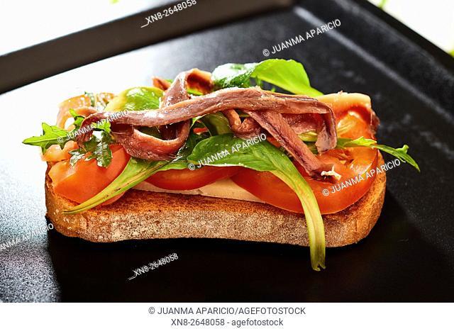 Spanish Tapa, Toast with Rocket (Arugula), Tomato, Lamb's Lettuce and Anchovies