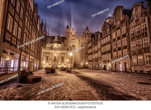 Gdansk winter street and view on Royal Chapel and St Mary's Church, Poland