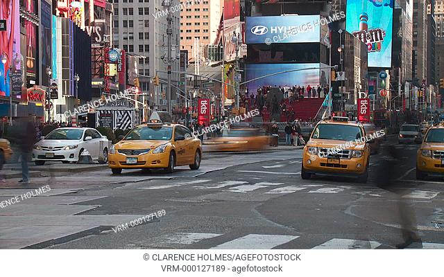 NEW YORK - MARCH 10: Vehicular and pedestrian traffic move through Times Square at the intersection of 7th Avenue and 45th Street in a timelapse sequence on...