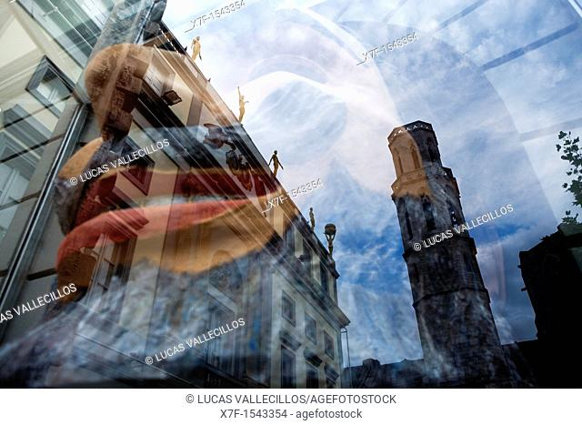 Church of Sant Pere Reflected in a Shop window of Dalí's Theatre Museum, that houses a sculpture, Figueres.Girona province. Catalonia. Spain