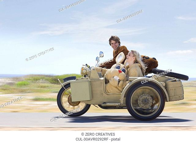 Disguised couple on motorbike