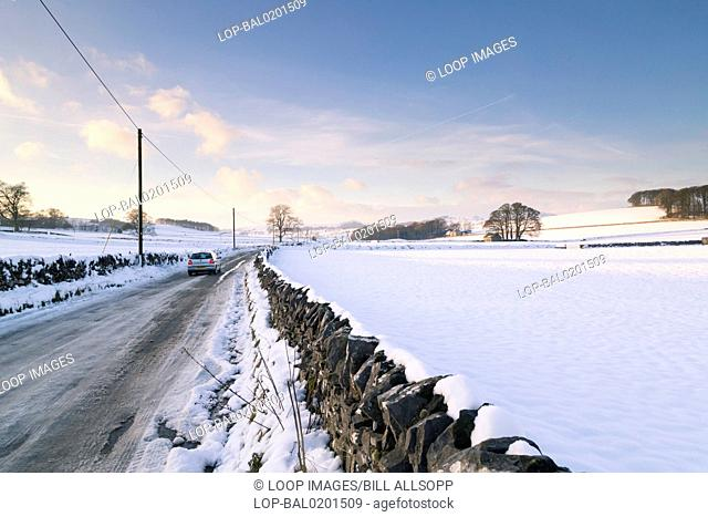 Driving along an icy country road in Derbyshire