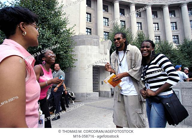 """Etan Thomas of the Washington Wizards signs some autographs and talks with fans during the DC hip hop Theatre Festival, during the Fest's """"Poetry Slam"""""""