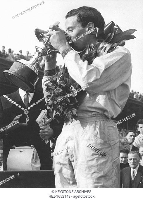 A trophy of champagne for driver Jim Clark, winner of the Aintree 200 race, April 1962. Scottish Formula One racing driver Jim Clark (1936-1968) was killed in a...