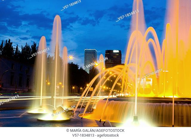 Illuminated fountain and Paseo de la Castellana, night view. Madrid, Spain