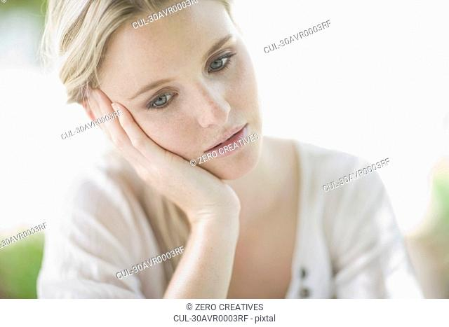 blond sad woman , thinking