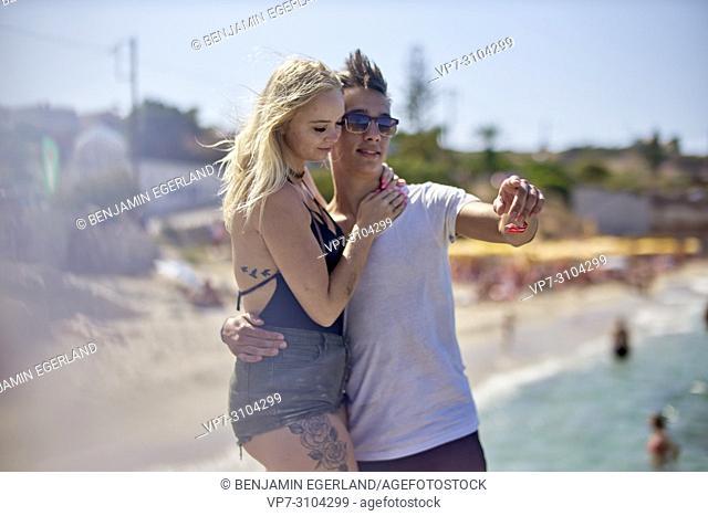 Greece, Crete, Chersonissos, couple at holiday beach, sunny weather