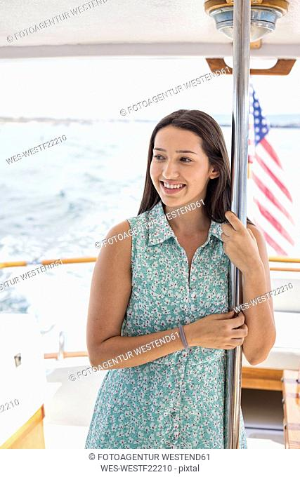 Smiling young woman on a boat trip