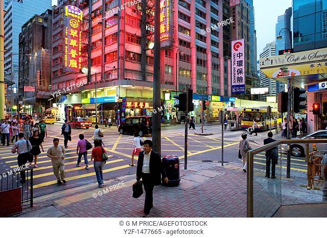 busy intersection at dusk, Hong Kong, China