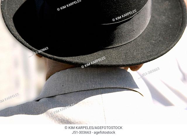 Asian man with black hat viewed from behind, head and shoulders. San Francisco. California, USA