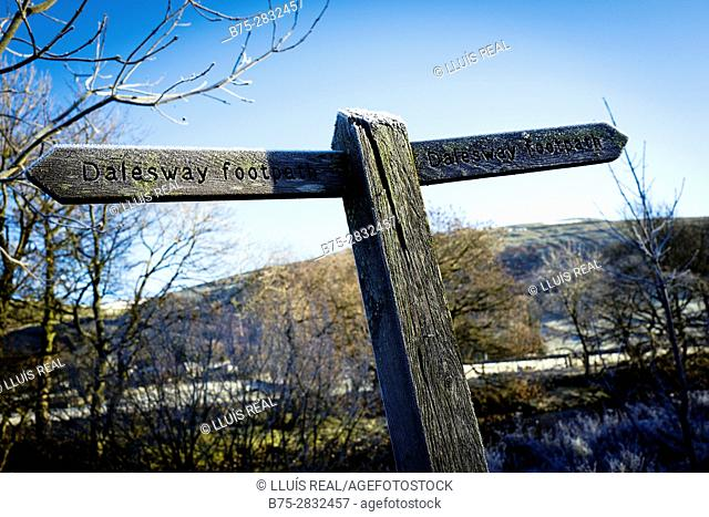 Wooden signpost of a trail (Dales Way footpath) on a cold morning with frost.. Buckden, Skipton, North Yorkshire, England, UK