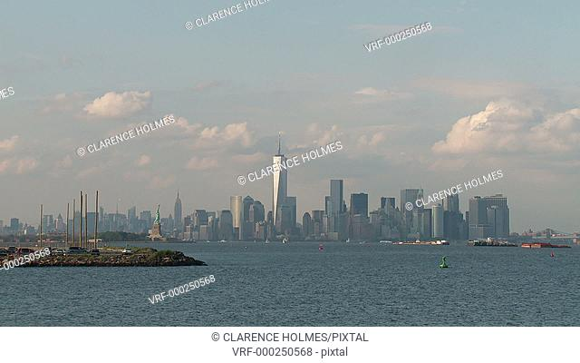 The Freedom Tower, part of the World Trade Center complex, rises over the skyline of lower Manhattan in New York City as viewed over New York Harbor and the...