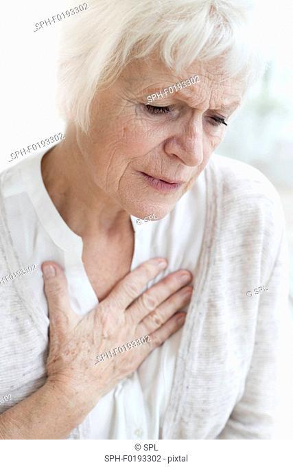 Senior woman touching chest